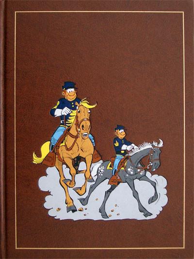 Couverture de Les tuniques bleues (Rombaldi) -15- Colorado story - Les Bleus se mettent au vert - Les quatre évangélistes - Carte blanche pour un bleu